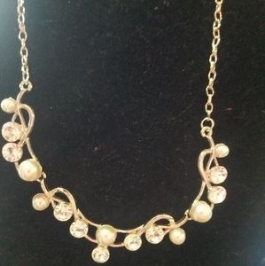Gold tone necklace with rhinestones.